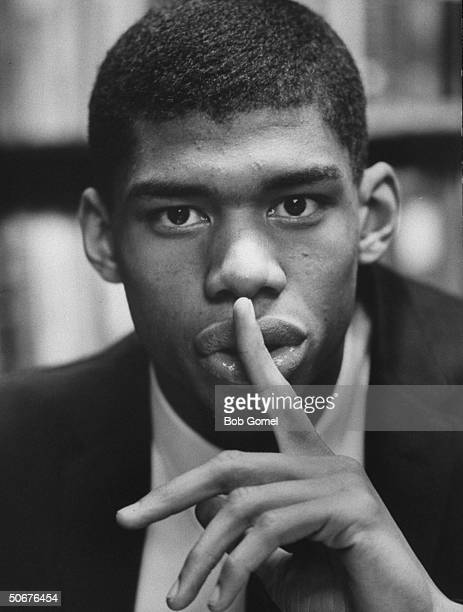 Close up shot of 7 '3/4tall power memorial academy basketball star Lewis Alcindor holding his finger over his mouth