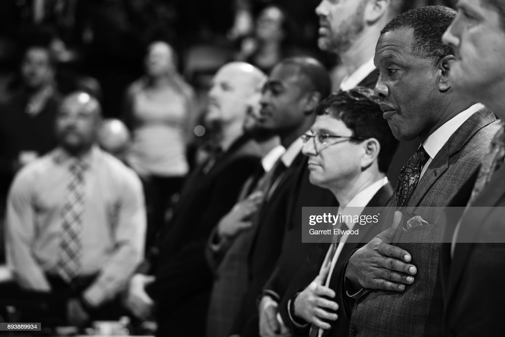 A close up shot of Alvin Gentry of the New Orleans Pelicans standing for the National Anthem before the game against the Denver Nuggets on December 15, 2017 at the Pepsi Center in Denver, Colorado.