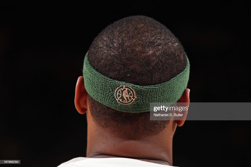 A close up shot of <a gi-track='captionPersonalityLinkClicked' href=/galleries/search?phrase=Carmelo+Anthony&family=editorial&specificpeople=201494 ng-click='$event.stopPropagation()'>Carmelo Anthony</a> #7 of the New York Knicks green week headband as he warms up before the game against the Milwaukee Bucks on April 5, 2013 at Madison Square Garden in New York City.