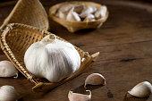 close up shot of garlic on wood background low key studio shot