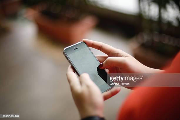 Close up shot of hands using handphone