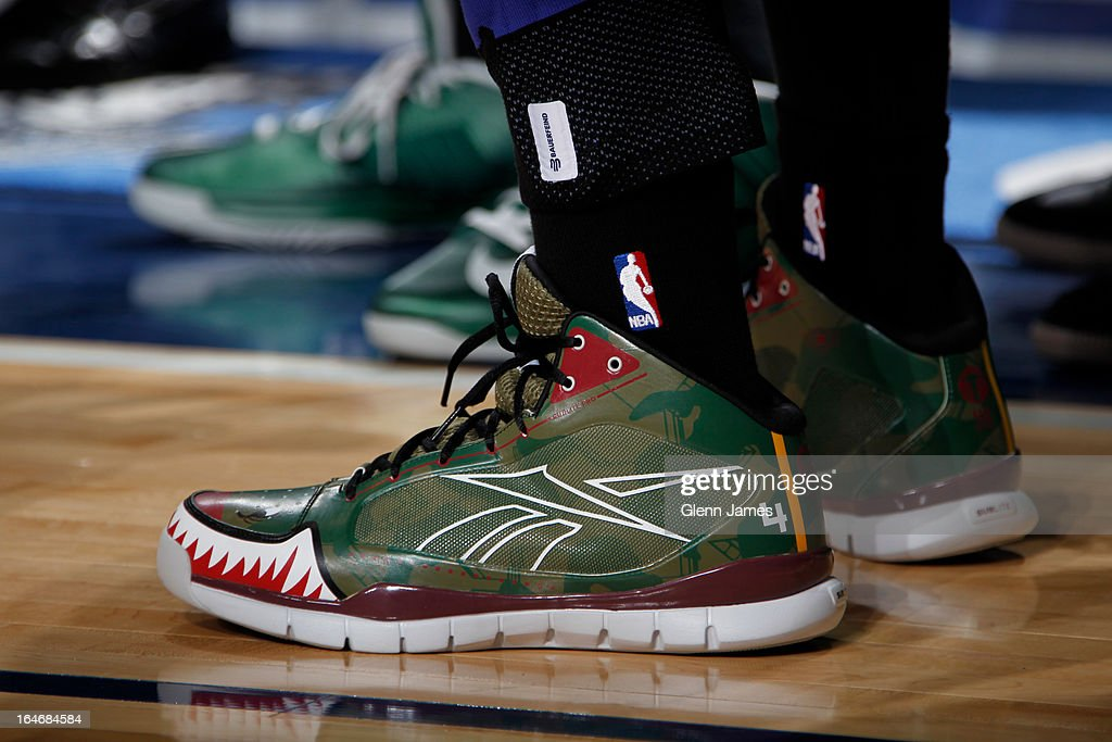A close up shot of <a gi-track='captionPersonalityLinkClicked' href=/galleries/search?phrase=Jason+Terry&family=editorial&specificpeople=201734 ng-click='$event.stopPropagation()'>Jason Terry</a> #4 of the Boston Celtics shoes during the game against the Dallas Mavericks on March 22, 2013 at the American Airlines Center in Dallas, Texas.