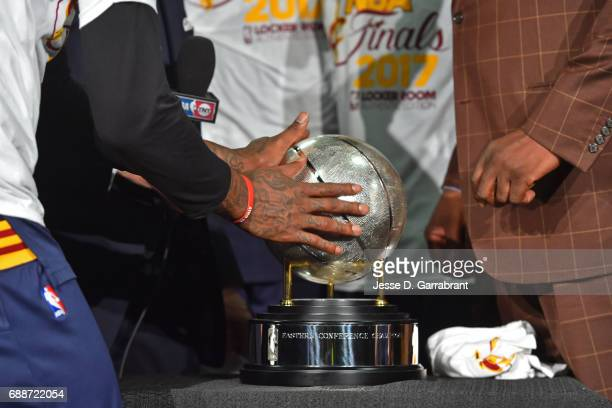 A close up shot of JR Smith of the Cleveland Cavaliers touching the Eastern Conference Championship Trophy after winning Game Five of the Eastern...