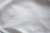 Close up shot of white textured football jersey