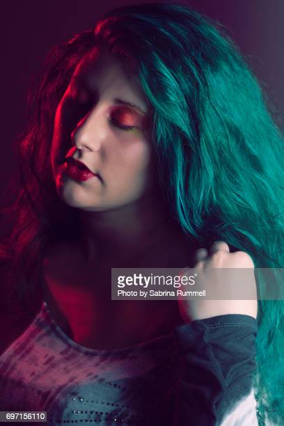 Close up shot of woman with teal hair