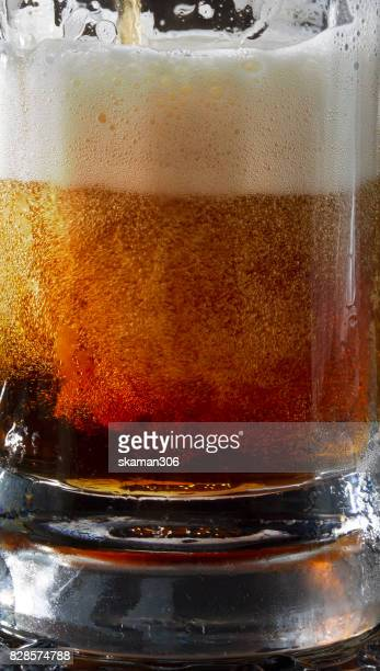 close up shot with Foam beer of German dark Beer inside Beer mug
