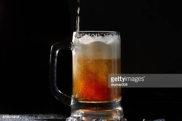close up shot with Foam beer of German dark Beer inside Beer mug