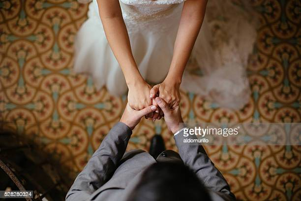 Close up shots of bride and groom holding hands