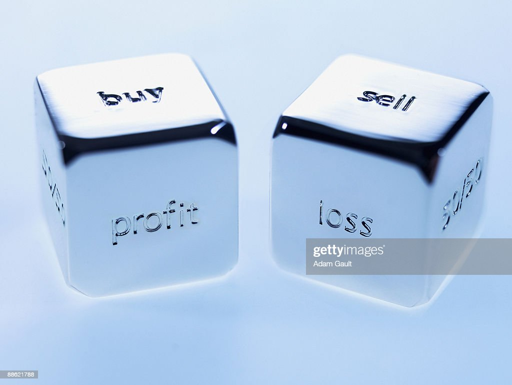 Close up silver cubes with sayings on them : Stock Photo