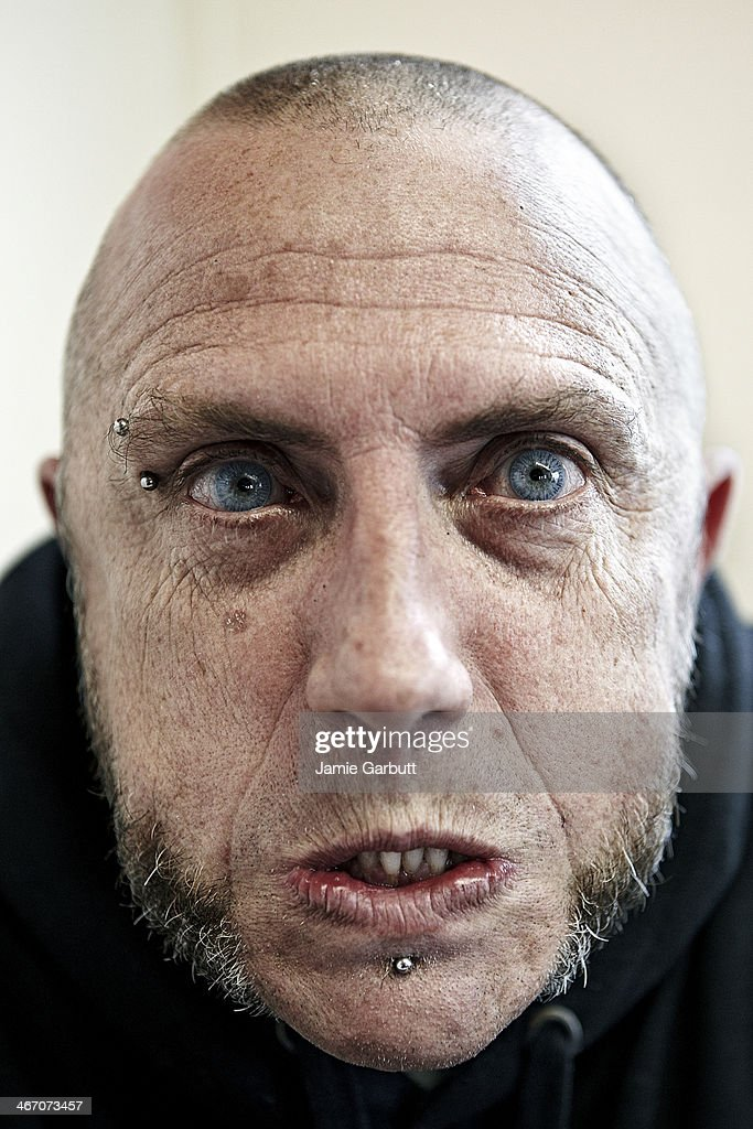 Close up skinhead male looking aggressive : Stock Photo