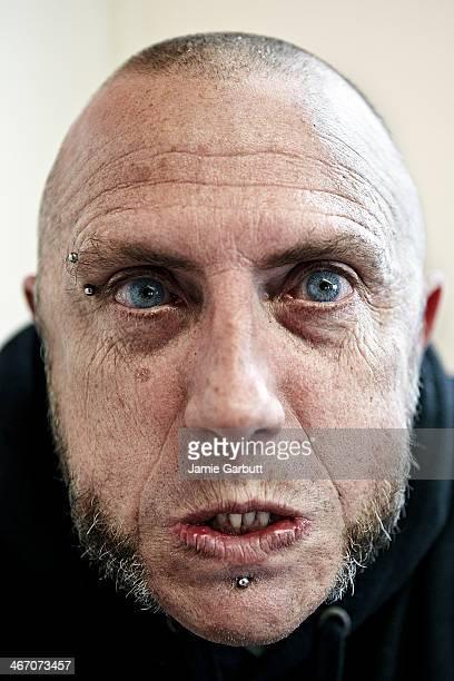 Close up skinhead male looking aggressive