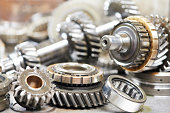 Close-up of automobile engine steel gears and bearings disassembled for repair at car service stationClick on banner below to view more images in the