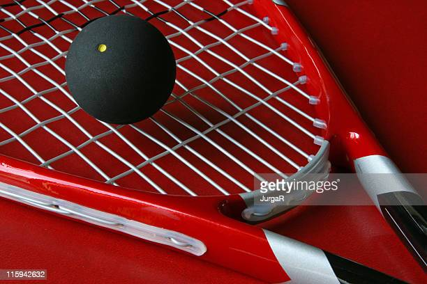 Close up squash racket and ball