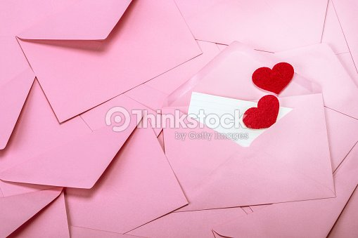 Close Up Stacking Of Pink Envelopes And Mail Letter Paper And Red