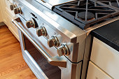 Close up stainless steel stove with oven, professional grade