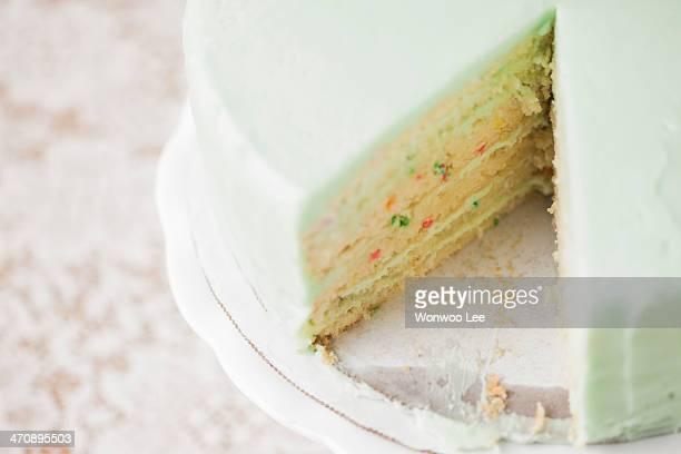 Close up still life of sliced celebration cake