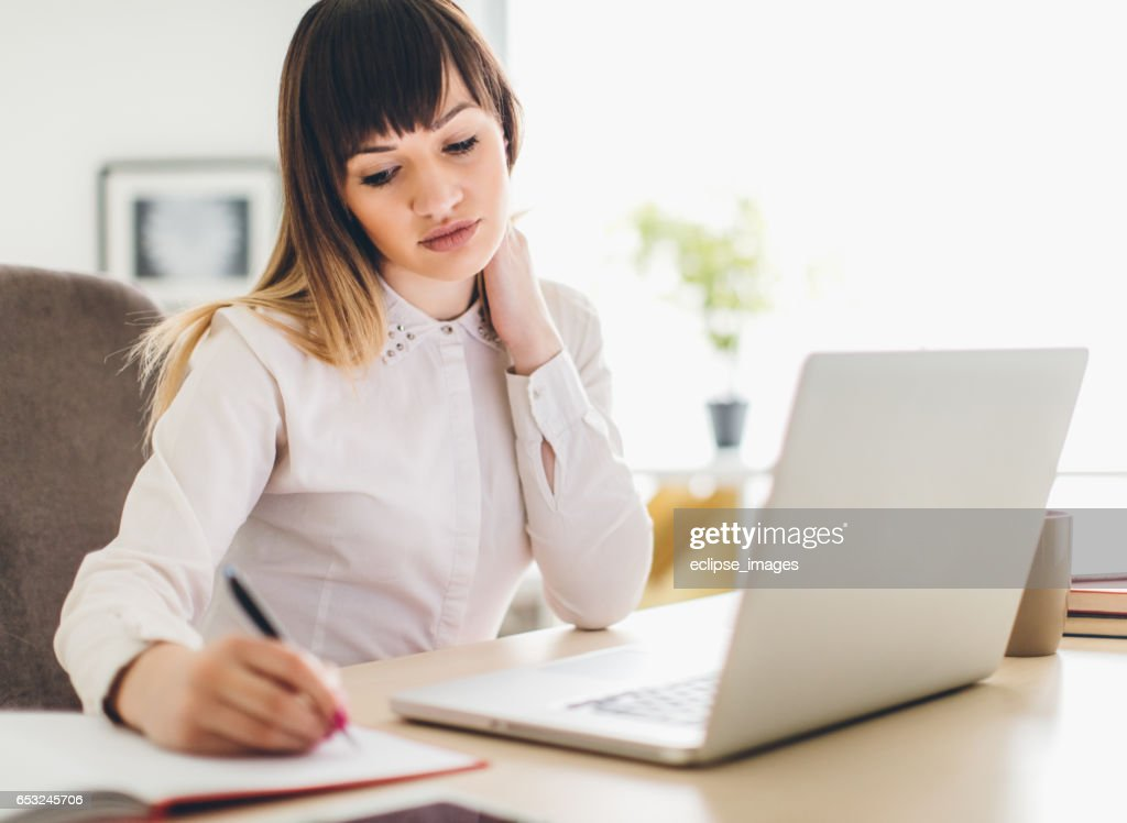 Close up student business hand laptop computer notes studying home : Stock Photo
