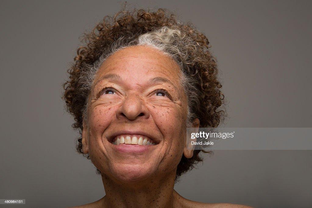 Close up studio portrait of smiling senior woman : Stock Photo