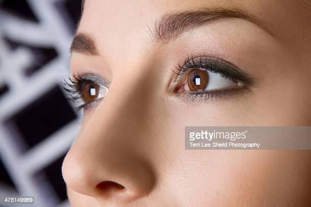 Close up studio portrait of young woman's eyes