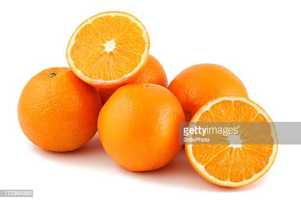 Close up studio shot of 5 oranges on white background