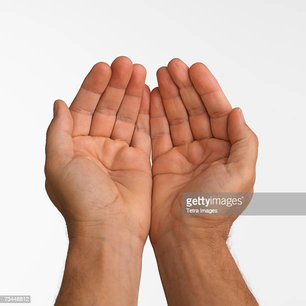 Close up studio shot of man's cupped hands