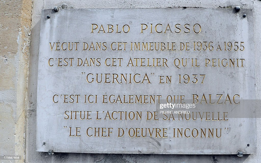Close up taken on August 6, 2013 in Paris, of the plaque which informs that Spanish artist Pablo Picasso lived in this buiding, in a place called 'Grenier Picasso' (Picasso Attic) from 1936 to 1955. Threatened with imminent eviction, the association, dedicated to artistic education, that runs the Attic Picasso, asked the government today not to provide assistance to police force as a new lawsuit is pending. Picasso created one of his major works 'Guernica' in this studio in 1937.