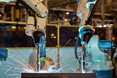 Close up torch body of robot welding in factory
