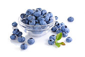 Healthy food. Close up view fresh ripe blueberry in glass bowl isolated on white background