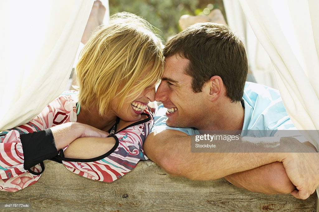 Close Up View Of A Boyfriend And Girlfriend Touching Noses