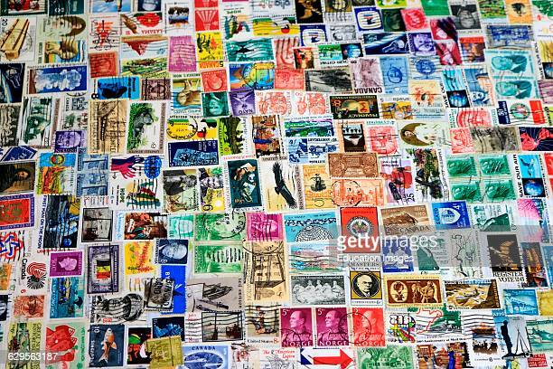 Close up view of a collage made of many old stamps from the United States and other countries These stamps covered all of the top of a small table...