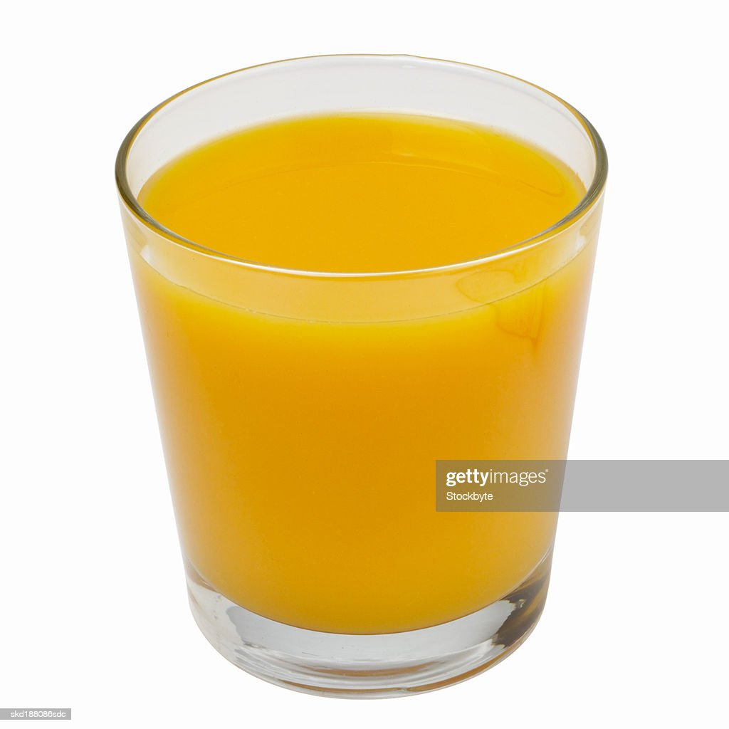 Close up view of a glass of orange juice : Stock Photo