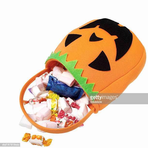 Close up view of a Halloween bag storing candy sweets
