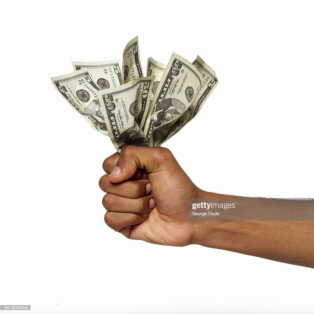 close up view of a hand holding bank notes : Stock Photo