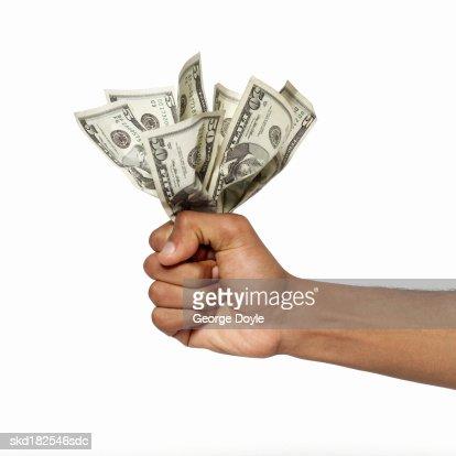 close up view of a hand holding bank notes : Bildbanksbilder