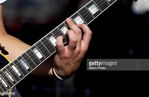 A close up view of a rock guitarist's left hand stretching to fret a difficult chord on a Gibson Les Paul guitar at Push 2004 on 8th March 2004 in...