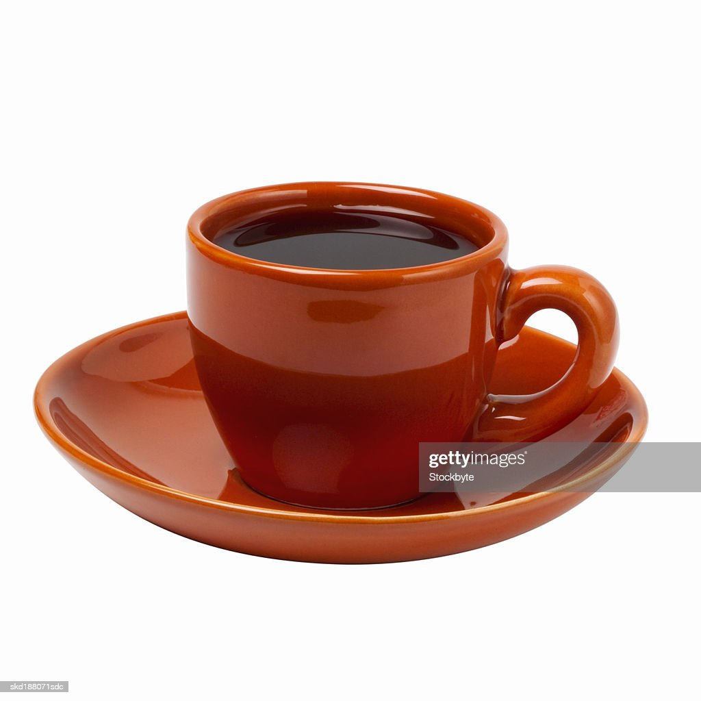 Close up view of a saucer and a cup of coffee : Stock Photo
