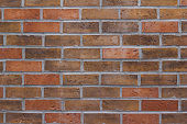 This abstract background features an attractive brick wall with varying colored bricks of brown and red.