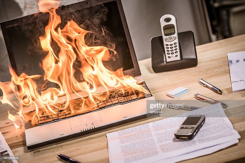 Close up view of burning laptop : Stock Photo