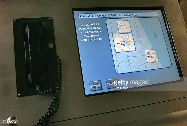 Close up view of Chicago area map with French instructions on a 'Welcome To Chicago Visitor Information' informational kiosk at O'Hare International...