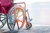 close up view of empty wheelchair with Pavement handicap symbol