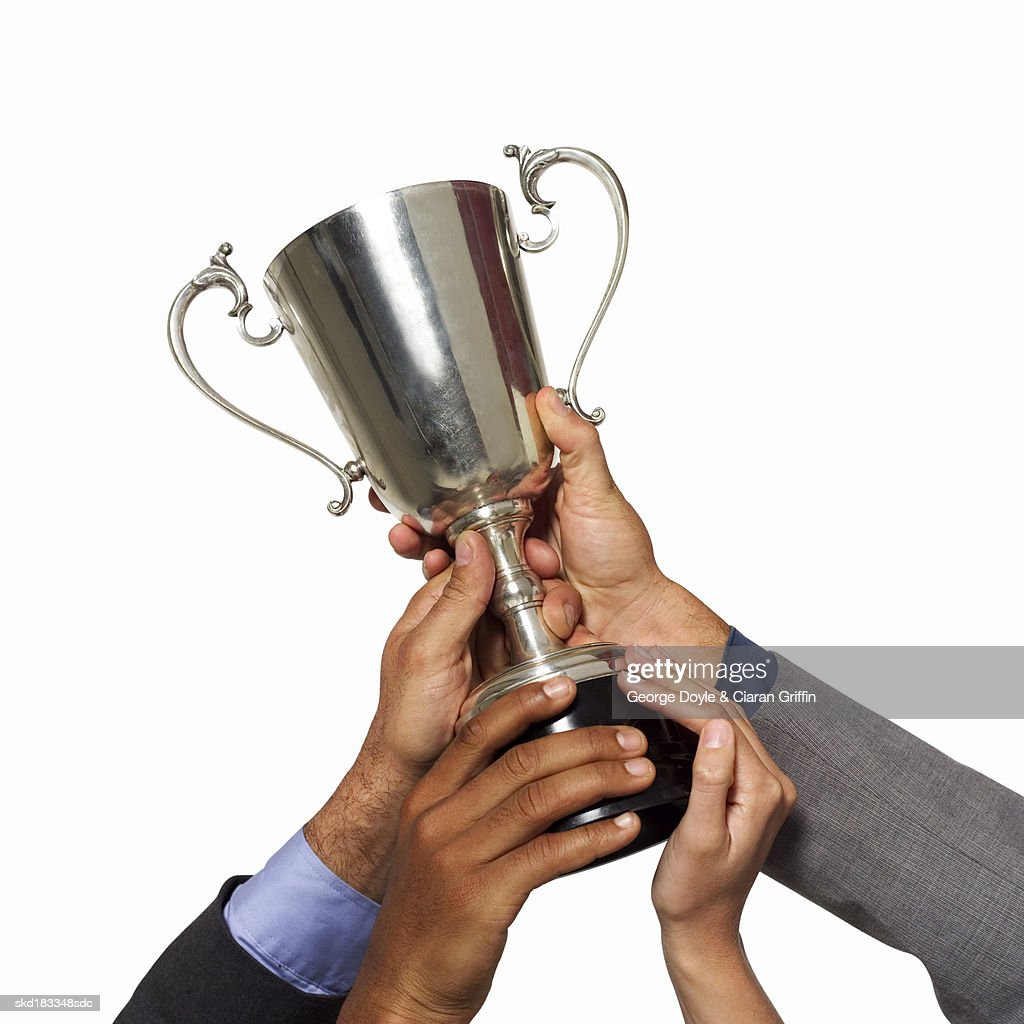 Close up view of hands holding a trophy : Stock Photo