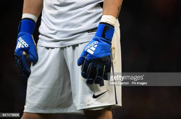 A close up view of Manchester City goalkeeper Claudio Bravo's gloves during the Emirates FA Cup Quarter Final Replay match at the Etihad Stadium...