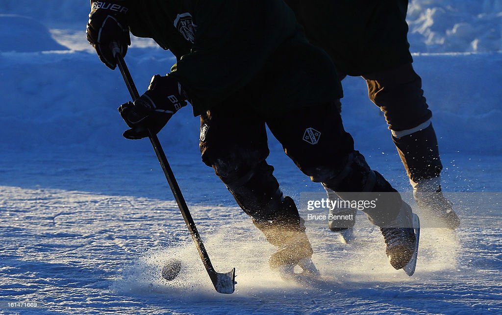 A close up view of pucks and sticks photographed at the 2013 USA Hockey Pond Hockey National Championships on February 8, 2013 in Eagle River, Wisconsin. The three-day tournament features 2,400 participants from 30 states playing a round robin tournament on 28 rinks laid out on Dollar Lake.