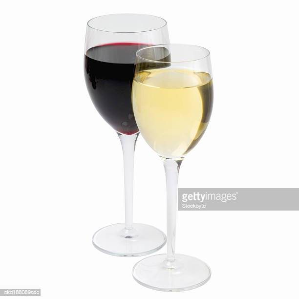 Close up view of red and white wine in two wineglasses