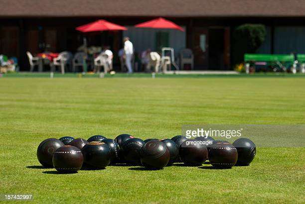 Close up view of several lawn bowling balls