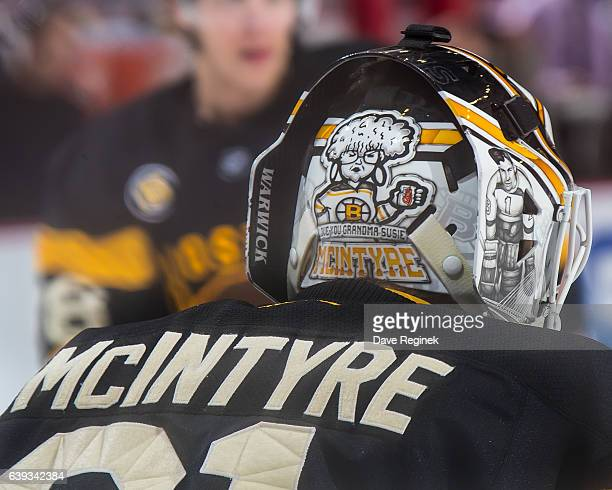 A close up view of the back of the mask of Zane McIntyre of the Boston Bruins in warm ups before an NHL game against the Detroit Red Wings at Joe...