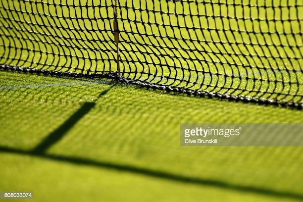A close up view of the net of a tennis court on day two of the Wimbledon Lawn Tennis Championships at the All England Lawn Tennis and Croquet Club on...