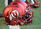 Close up view of the new satin red football helmets worn by the Utah Utes during their game against the Michigan Wolverines at RiceEccles Stadium on...