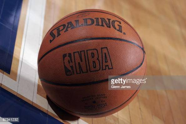 Close up view of the official NBA logo on a Spalding basketball as it rests on the court during a game between the Golden State Warriors and the...