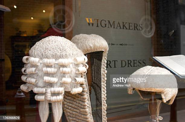 A close up view of the shop front of the wig makers Ede and Ravenscroft on Gracechurch Street in the City of London.